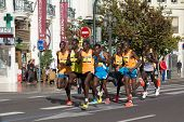 VALENCIA, SPAIN - NOVEMBER 16, 2014: The lead runners of the 2014 Valencia Marathon. Runner number 4, front left, Jacob Kendagor won the event with a time of 2:08:37.