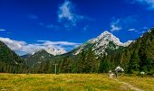 foto of mountain chain  - Old lodge in mid mountain at Slovenia ski vacation resort - JPG