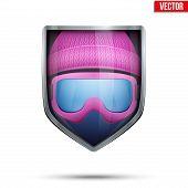 Bright shield in the winter cap and ski goggles inside. Vector.