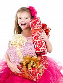 Happy Adorable Little Girl With Christmas Gift Boxes