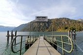 TYROL, AUSTRIA - OCTOBER 2013 :  A pier for boat trips on Achensee Lake on October 20, 2013 in Tirol, Austria. The Achensee is the largest lake within the federal state with a depth of 133 metres.