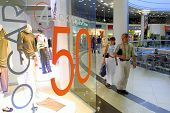 KIEV, UKRAINE, 16 AUGUST 2003: Shoppers hunt for bargains at an upscale mall in Kiev, Ukraine.