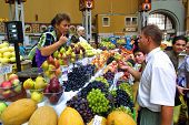KIEV, UKRAINE, 16 AUGUST 2003:  Shoppers hunt for locally made fruits and vegetables at a covered market in Kiev.