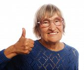 image of 70-year-old  - Old happy woman showing ok sign on a white background - JPG