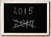 New Year Coming Concept - 2015 And 2014 Written On A Blackboard