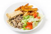 Chicken and mushroom suet pudding, steamed in a a basin, and old-fashioned English speciality