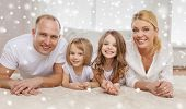 family, childhood, people and home concept - smiling parents with two little girls talking at home
