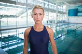 Portrait of a female swimmer by the pool at leisure center