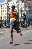 VALENCIA, SPAIN - NOVEMBER 16, 2014: Woman runner Alem Fikre Kifle of Ethiopia competes in the 2014 Valencia Marathon.  Kifle finished in 5th place (women division) with a time of 2:34:09.