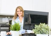 Happy woman sitting at her desk at work
