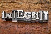 integrity word in vintage metal type printing blocks over grunge wood
