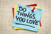 do things you love reminder on a green sticky note against burlap canvas