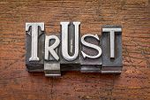 trust word in vintage metal type printing blocks over grunge wood