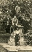 POLAND, CIRCA FIFTIES: Vintage photo of couple posing with naked statue in park