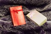 Red Gift Box On Wool Texture.