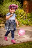Girl with balloon and lollipop