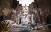 stock photo of chums  - Phra Ajana the big Buddhist statue at Wat Si Chum Sukhothai Historical Park Thailand - JPG