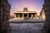 picture of karnataka  - Ancient temple with columns at violet sky in Hampi Karnataka India - JPG