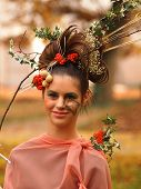 Portrait Of Beautiful Girl With Autumn Leaves And With Stylish Makeup.