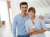 Happy young couple moving in together in new apartment