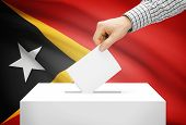 Voting Concept - Ballot Box With National Flag On Background - East Timor