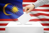 Voting Concept - Ballot Box With National Flag On Background - Malaysia