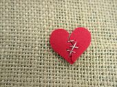 picture of broken hearted  - A red broken heart stitched with thread - JPG