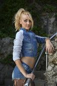 Young Pretty Blond Woman In Trendy Denim Fashion