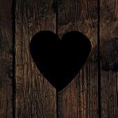 Heart symbol on wooden texture.