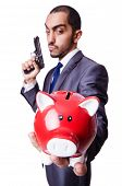 Businessman killing the piggy bank