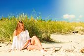 picture of dune grass  - Young woman female model in full length posing outdoor on background of dunes sky and grass - JPG