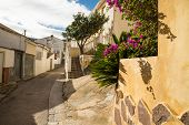 stock photo of costa blanca  - Charming street of one of the many small mountain villages on Costa Blanca Spain - JPG