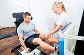 image of physical exercise  - Patient at the physiotherapy doing physical exercises using leg press in sport remobilization - JPG