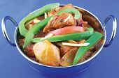 image of kadai  - spicy dry chicken indian style in a kadai garnished wiht peppers and ginger - JPG