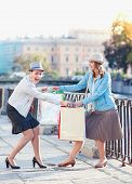 image of revenge  - Two beautiful girls with shopping bags having fight in the city outdoor - JPG