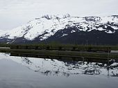 Train and Mountain Reflected in Lake