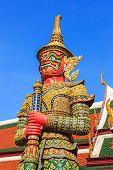 foto of budha  - One of twelve giant guardians characters from the Thai Ramakien epic guarding the gate of Wat Phra Kaeo - JPG
