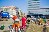 picture of geodesic  - Surveying measuring equipment level transit on tripod at construction building area site - JPG