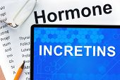 stock photo of hormone  - Papers with hormones list and tablet  with word incretins - JPG