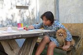 picture of pomeranian  - file of girl and pomeranian dog at home - JPG