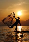 stock photo of fishermen  - Traditional fisherman at work - JPG