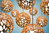 stock photo of chandelier  - Chandeliers of orange colour hang on a wire - JPG
