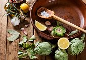 foto of artichoke hearts  - Concept of cooking with artichoke on a wooden background - JPG