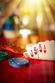 stock photo of poker hand  - Heavenly light illuminates a winning hand in this poker background photo