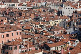 stock photo of overpopulation  - lots of houses with red - JPG