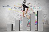 picture of step-up  - Young businesswoman stepping up on chart bar - JPG