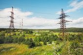 picture of power transmission lines  - Transmission line on a background of blue sky day  - JPG