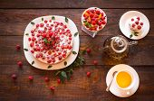 stock photo of teapot  - Appetizing vegetarian pie from protein jelly with fresh berries of raspberry and mint a teapot and a cup with green tea - JPG