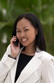 Business Woman With Cell Phone Looking At Camera