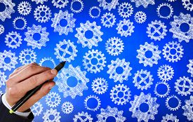 image of mechanical drawing  - Close up of hand drawing gears mechanism with marker - JPG